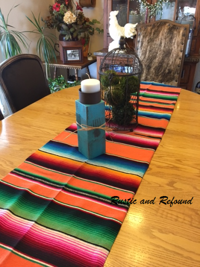 turqoise candle holders and serape