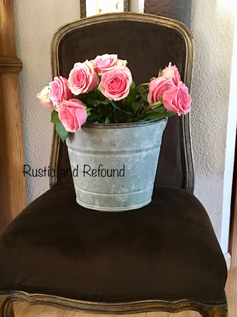 brown chair-pink roses