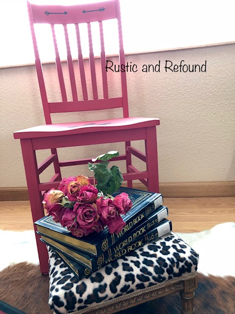 Red chair with books