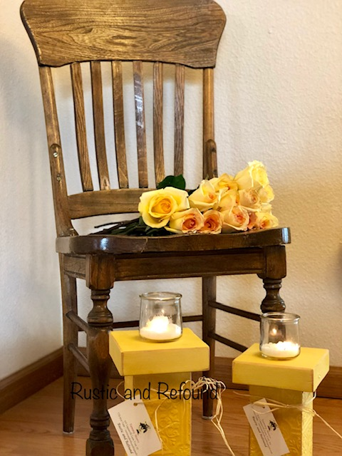 wooden chair w-yellow candle holders