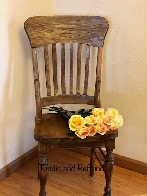Wooden chair with yellow roses