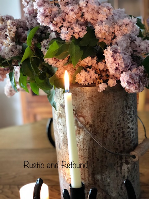 candle in front of lilacs 6-18-19